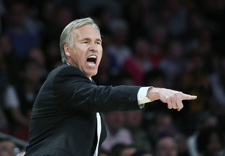 Photo - FILE - In this April 13, 2014, file photo, Los Angeles Lakers head coach Mike D'Antoni gestures to his team during the second half of an NBA basketball game against the Memphis Grizzlies in Los Angeles. D'Antoni has resigned after less than two seasons on the job. Lakers spokesman John Black confirmed D'Antoni's resignation Wednesday, April 30. (AP Photo/Mark J. Terrill, File)