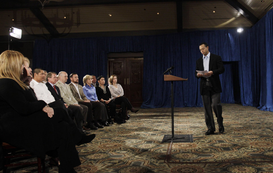 Photo - Tiger Woods approaches the podium during a news conference, Friday, Feb. 19, 2010, in Ponte Vedra Beach, Fla. (AP Photo/Eric Gay) ORG XMIT: FLEG106