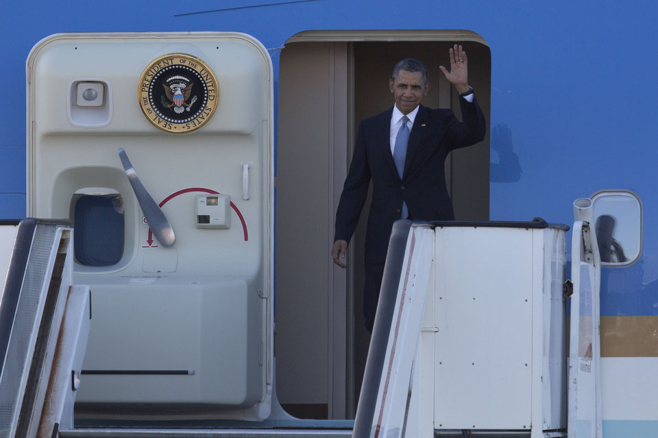 Photo - President Barack Obama waves from Air Force One upon arrival at Schiphol Amsterdam Airport, Netherlands, Monday March 24, 2014. Obama will attend the two-day Nuclear Security Summit in The Hague. (AP Photo/Peter Dejong, POOL)