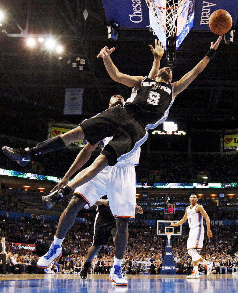 San Antonio's Tony Parker (9) takes a shot in front of Oklahoma City's Serge Ibaka (9) during the NBA basketball game between the Oklahoma City Thunder and the San Antonio Spurs at Chesapeake Energy Arena in Oklahoma City, Friday, March 16, 2012. Photo by Nate Billings, The Oklahoman