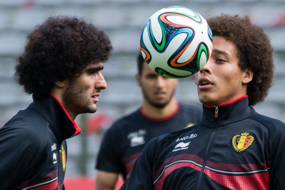 Photo - Belgium's national soccer team players Axel Witsel, right, and Marouane Fellaini practice during their last training in Belgium before leaving for Brazil at the King Baudouin stadium in Brussels, Sunday June 8, 2014. Belgium will play against South Korea, Russia and Algeria in Group H of the World Cup 2014 in Brazil. (AP Photo/Geert Vanden Wijngaert)