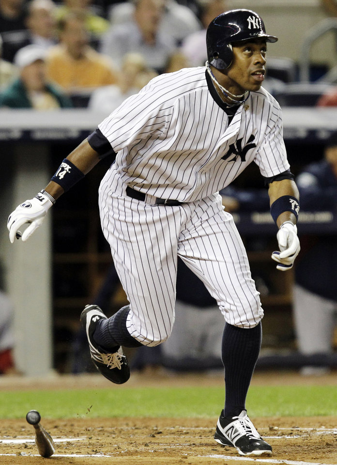 Photo -   New York Yankees' Curtis Granderson watches his second-inning, two-run home run off Boston Red Sox starting pitcher Clay Buchholz during their baseball game at Yankee Stadium in New York, Monday, Oct. 1, 2012. (AP Photo/Kathy Willens)
