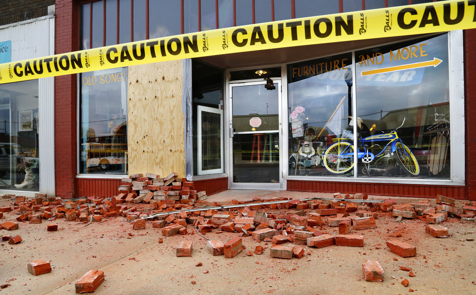 Photo - Displaced bricks on the sidewalk at the door of this storefront on E. Broadway in downtown Cushing. Damage in Cushing on Monday, Nov. 7, 2016, caused by Sunday night's 5.0 magnitude earthquake. Photo by Jim Beckel, The Oklahoman