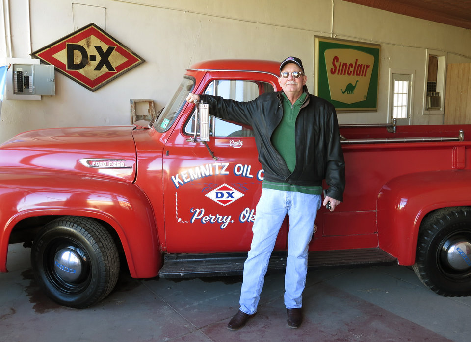 Photo -  Craig Kemnitz, owner of the Kemnitz Sinclair Station in Perry, stands beside a 1953 Ford pickup the Kemnitz Oil Co. Inc. used to haul drums of lubricant oil to drilling rigs. Wednesday, February 3, 2016. [Photos by Paul Monies, The Oklahoman]