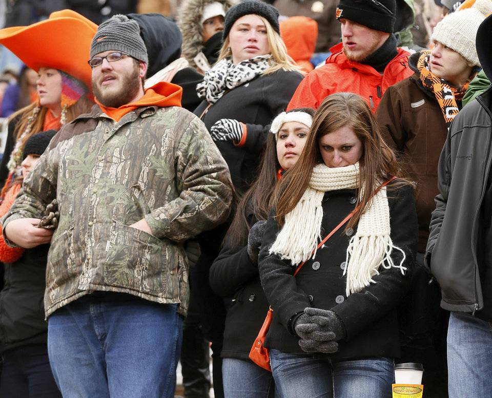 Photo - OSU fans react after the Cowboys lost the Bedlam college football game between the Oklahoma State University Cowboys (OSU) and the University of Oklahoma Sooners (OU) at Boone Pickens Stadium in Stillwater, Okla., Saturday, Dec. 7, 2013. OU won, 33-24. Photo by Nate Billings, The Oklahoman
