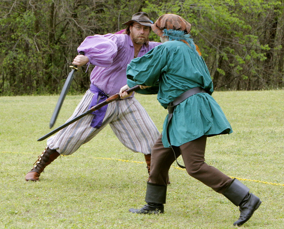 Photo - William Dalley. left, and James Engman practice swordfighting during the Iron Thistle Scottish Heritage Festival.  Photo By Paul Hellstern, The Oklahoman  PAUL HELLSTERN - Oklahoman