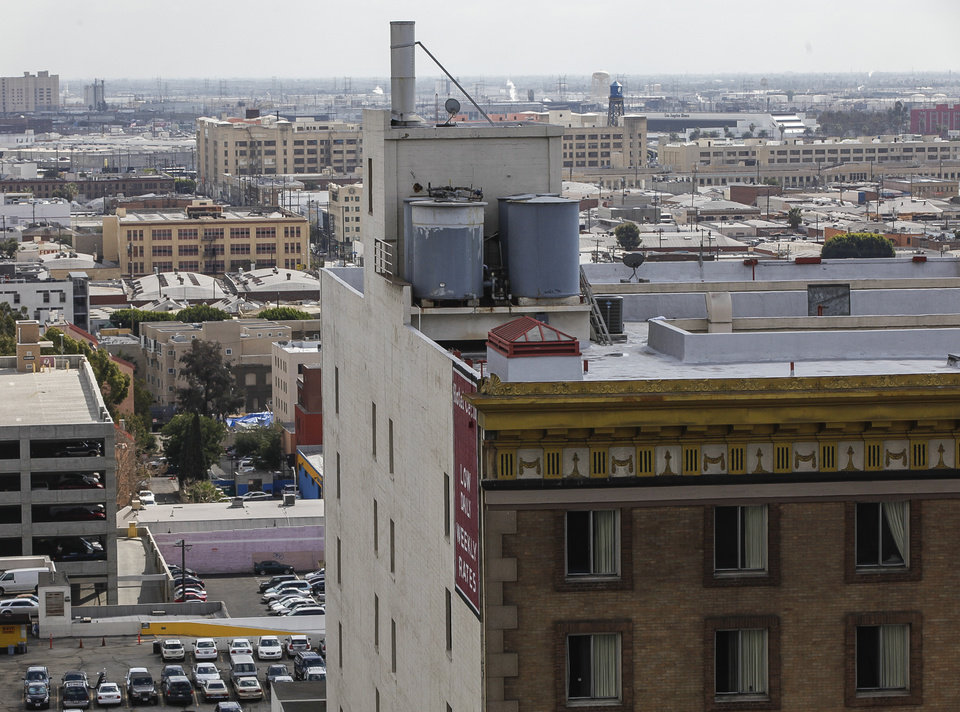 This Thursday, Feb. 21, 2013 photo shows water tanks on the roof of the Cecil Hotel in Los Angeles Thursday, Feb. 21, 2013.  Canadian tourist Elisa Lam  had been missing for about two weeks when officials at the Cecil Hotel found her body in a water cistern on the hotel roof. Guest complaints about low water pressure prompted a maintenance worker to make the gruesome discovery Tuesday, and officials were trying to determine if the 21-year-old was killed or if her death was a bizarre accident. (AP Photo/Damian Dovarganes)