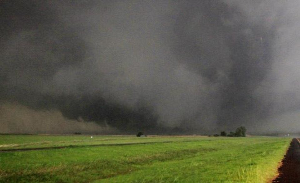Photo - A half-mile-wide tornado moves north in Canadian County having just crossed SH 3, the Northwest Expressway, west of SH 4 moving towards Piedmont Tuesday, May 24, 2011.