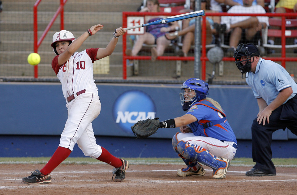 Photo - Alabama's Kaila Hunt (10) hits a foul ball during the Women's College World Series game between Alabama and Florida at the ASA Hall of Fame Stadium in Oklahoma City, Sunday, June 5, 2011. Photo by Garett Fisbeck, The Oklahoman