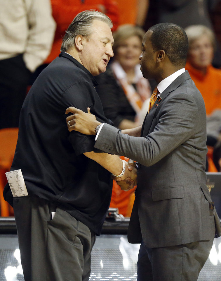 Photo - West Virginia coach Bob Huggins, left, and Oklahoma State coach Mike Boynton Jr. talk before a men's college basketball game between the Oklahoma State Cowboys and West Virginia Mountaineers at Gallagher-Iba Arena in Stillwater, Okla., Monday, Jan. 6, 2020. [Nate Billings/The Oklahoman]