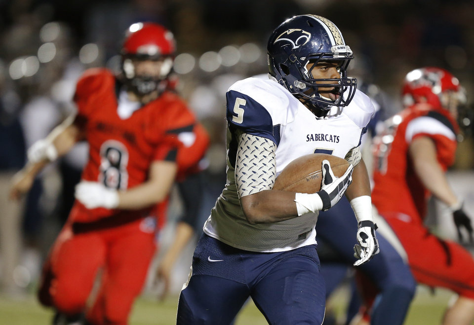 Photo - Southmoore's Pierce Spead runs against Mustang during their high school football game in Mustang, Okla., Friday, November 8, 2013. Photo by Bryan Terry, The Oklahoman