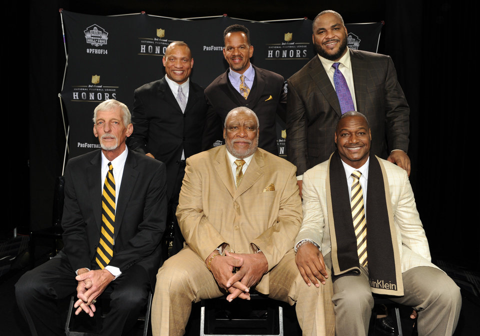 Photo - Clockwise from top left, defensive back Aeneas Williams, wide receiver Andre Reed, offensive tackle Walter Jones, linebacker Derrick Brooks , defensive lineman Claude Humphrey and punter Ray Guy pose for a photo at the NFL Honors show Saturday, Feb. 1, 2014 at Radio City Music Hall in New York. (Photo by Frank Micelotta/Invision for NFL/AP Images)