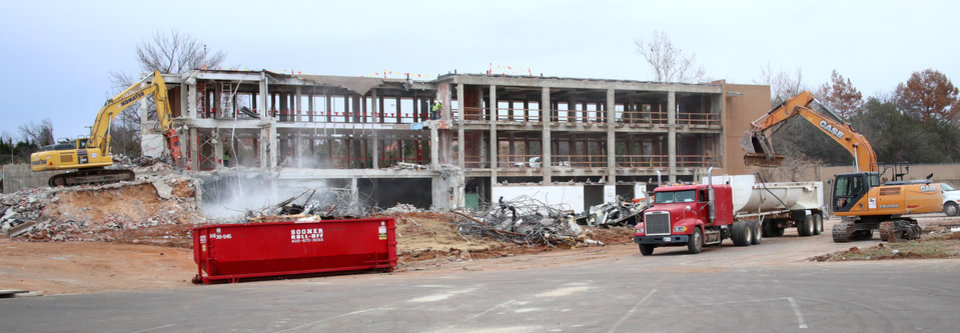 Photo -  Demolition is proceeding at the former Oklahoma Wildlife Building on Thursday. [Photo by Doug Hoke, The Oklahoman]