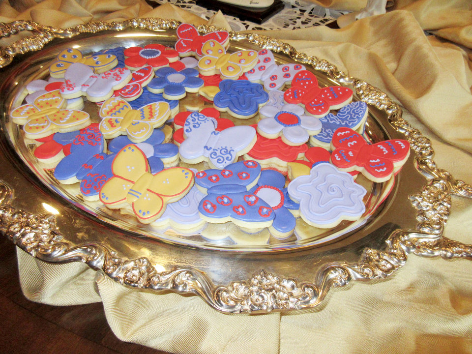 Photo - Butterfly and flower- decorated cookies. PHOTO BY HELEN FORD WALLACE, THE OKLAHOMAN