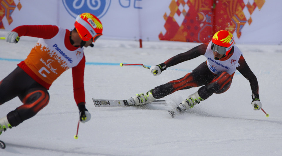 Photo - Yon Santacana Maiztegui of Spain, right, and his guide Miguel Galindo Garces race to win the men's downhill, visually impaired event at the 2014 Winter Paralympic, Saturday, March 8, 2014, in Krasnaya Polyana, Russia. (AP Photo/Dmitry Lovetsky)