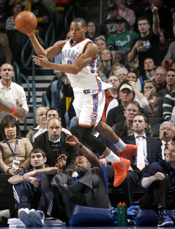 Photo - Oklahoma City's Russell Westbrook passes the ball during the NBA basketball game between the Oklahoma City Thunder and the Dallas Mavericks at the Ford Center in Oklahoma City on Wednesday, December 16, 2009. Photo by Bryan Terry, The Oklahoman