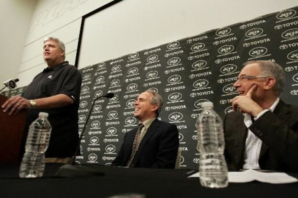 Photo - New York  Jets head coach Rex Ryan, left, talks as Ross Greenburg, center, president of  HBO Sports, and Steve Sabol, right, president of NFL films listen during an announcement that the three will team up for Hard Knocks:  Training  Camp  with the New York  Jets which will debut in August on  HBO, during a press conference at the team's practice facility in Florham Park, NJ on Thursday, March 25, 2010. (AP Photo/Rich Schultz)