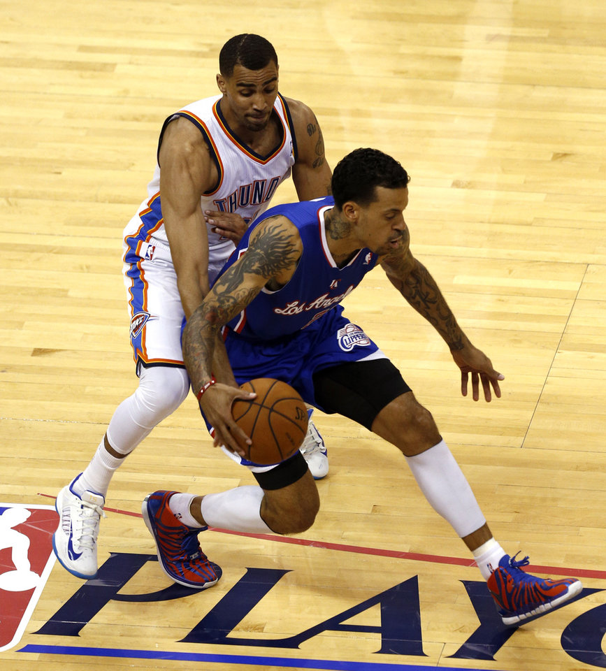 Photo - Oklahoma City's Thabo Sefolosha (25) defends against Los Angeles' Matt Barnes (22) during Game 2 of the Western Conference semifinals in the NBA playoffs between the Oklahoma City Thunder and the Los Angeles Clippers at Chesapeake Energy Arena in Oklahoma City, Wednesday, May 7, 2014. Photo by Sarah Phipps, The Oklahoman