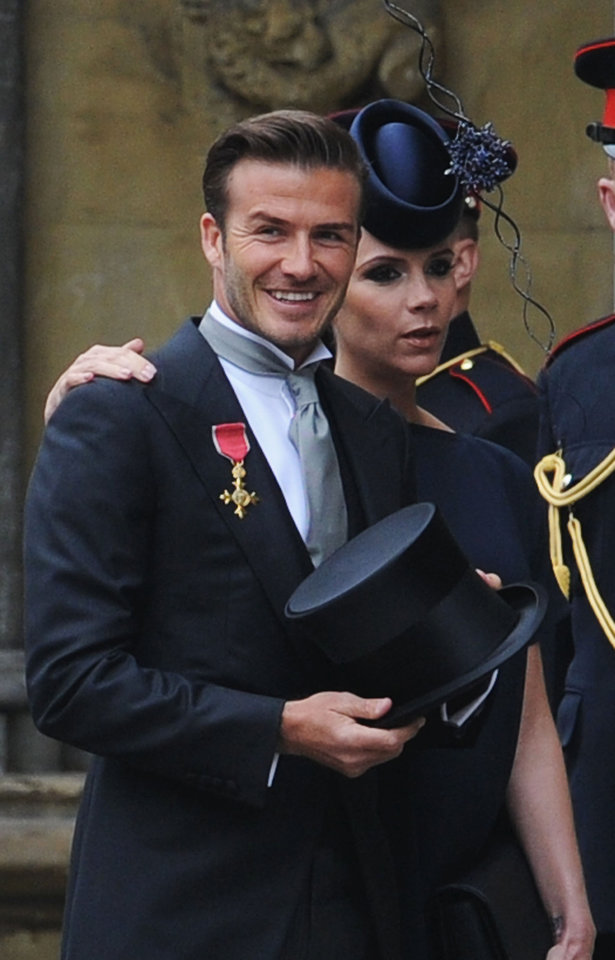 Photo - English soccer player David Beckham arrives with his wife Victoria Beckham for the wedding service of Britain's Prince William and Kate Middleton at Westminster Abbey, London, Friday April 29, 2011. (AP Photo/Jasper Juinen, Pool)  ORG XMIT: RWDJ117