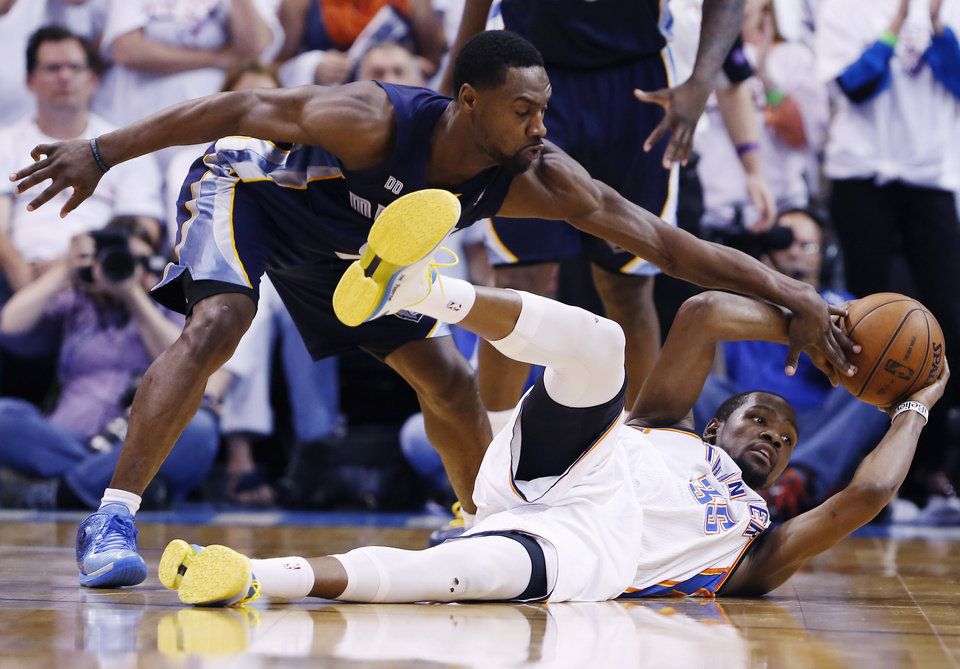 Photo - Oklahoma City Thunder's Kevin Durant slips and falls as Memphis Grizzlies Tony Allen blocks his pass during the final seconds of Game 2 of their Western Conference Semifinals NBA basketball playoff series in Oklahoma City, Tuesday, May 7, 2013.  (AP Photo/Alonzo Adams) ORG XMIT: TXKJ142