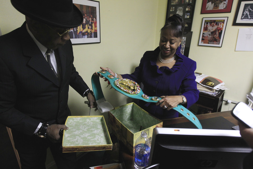 THIS CORRECTS TO STEWARD\'S DAUGHTER, NOT SISTER - Emanuel Steward\'s daughter Sylvia Steward-Williams holds a championship belt created by the World Boxing Council (WBC) honoring Emanuel Steward at the trainer\'s office in Detroit, Tuesday, Nov. 13, 2012. A funeral service for the late boxing trainer was held Tuesday in Detroit. (AP Photo/Carlos Osorio)