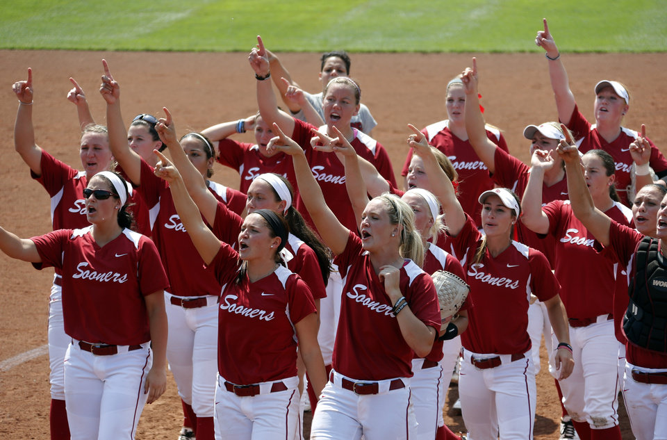 Oklahoma celebrates their win over Arkansas during the Norman Regional of the 2013 NCAA Division I Softball Women\'s College World Series as the University of Oklahoma (OU) Sooners play the Arkansas Razorbacks at Marita Hines Field, Sunday, May 19, 2013. Photo by Sarah Phipps, The Oklahoman