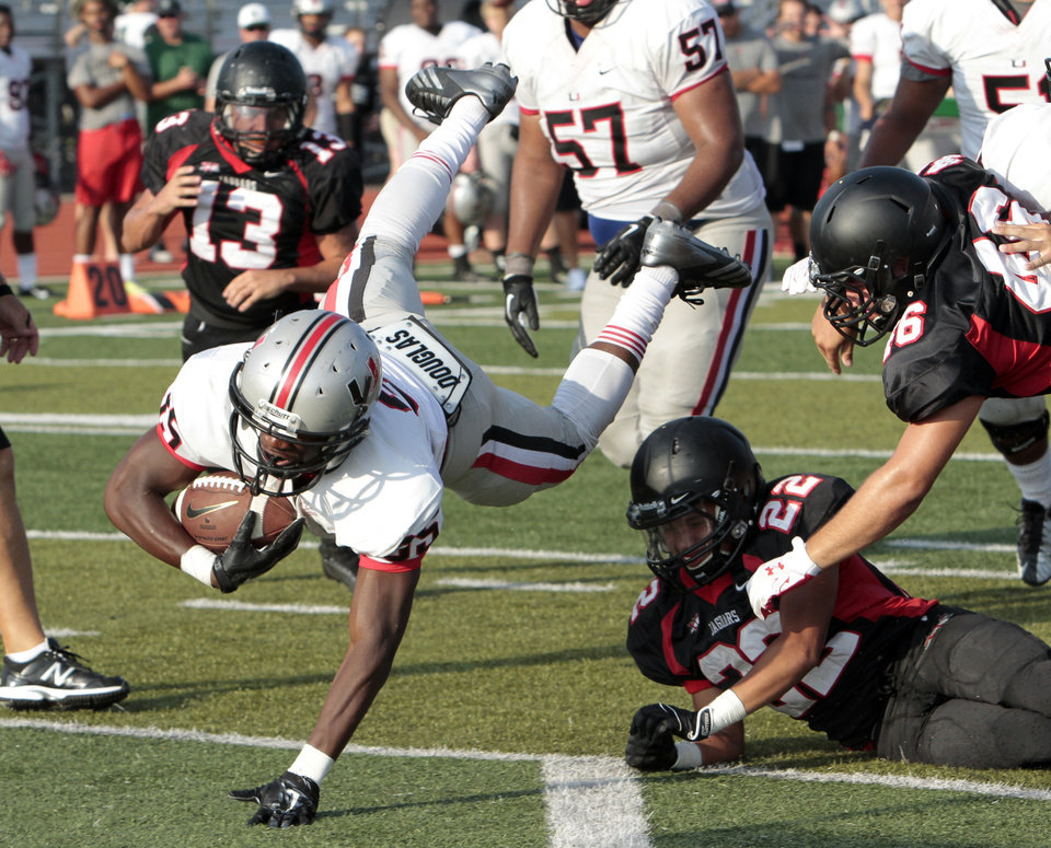 Photo -  Tulsa Union's Amani Griffith scores against Westmoore at a high school football scrimmage at Harve Collins Field in Norman, Okla., on Thursday, Aug. 21, 2014. Photo by Steve Sisney, The Oklahoman