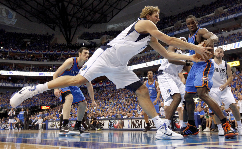 Dirk Nowitzki (41) of Dallas and Oklahoma City\'s Serge Ibaka (9) go for the ball during game 2 of the Western Conference Finals in the NBA basketball playoffs between the Dallas Mavericks and the Oklahoma City Thunder at American Airlines Center in Dallas, Thursday, May 19, 2011. Photo by Bryan Terry, The Oklahoman