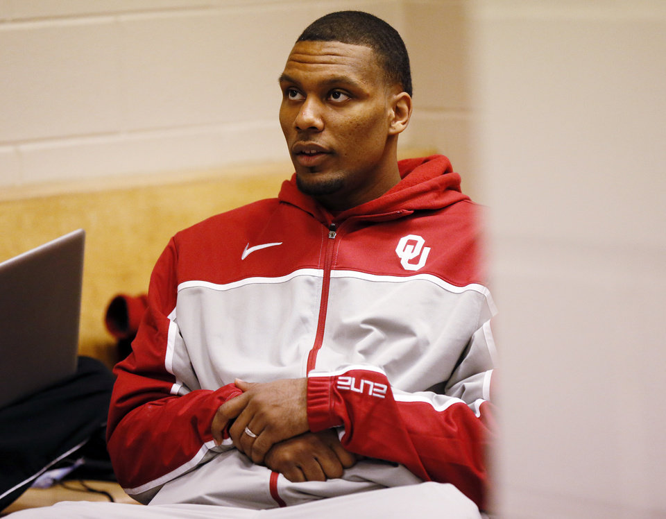 Oklahoma's Romero Osby (24) watches OSU play Oregon in the OU locker room during the practice and press conference day for the second round of the NCAA men's college basketball tournament at the Wells Fargo Center in Philadelphia, Thursday, March 21, 2013. OU will play San Diego State in the second round on Friday. Photo by Nate Billings, The Oklahoman