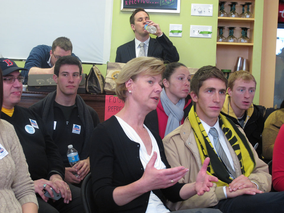 Democratic Senate candidate Tammy Baldwin watches a Green Bay Packers-Arizona Cardinals game with staffers at a Milwaukee campaign headquarters on Sunday, Nov. 4, 2012. Baldwin and Republican opponent Tommy Thompson suspend voter-outreach efforts during all Packers games, saying Wisconsinites never want their phones or doorbells to ring while they're watching the game. (AP Photo/Dinesh Ramde)