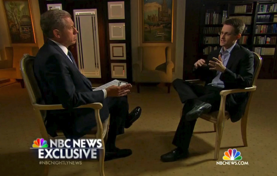 Photo - In this image taken from video provided by NBC News on Tuesday, May 27, 2014, Edward Snowden, a former National Security Agency (NSA) contractor, right, speaks to NBC News anchor Brian Williams, left, during an NBC Exclusive interview. Snowden told Williams that he worked undercover and overseas for the CIA and the NSA. (AP Photo/NBC News)