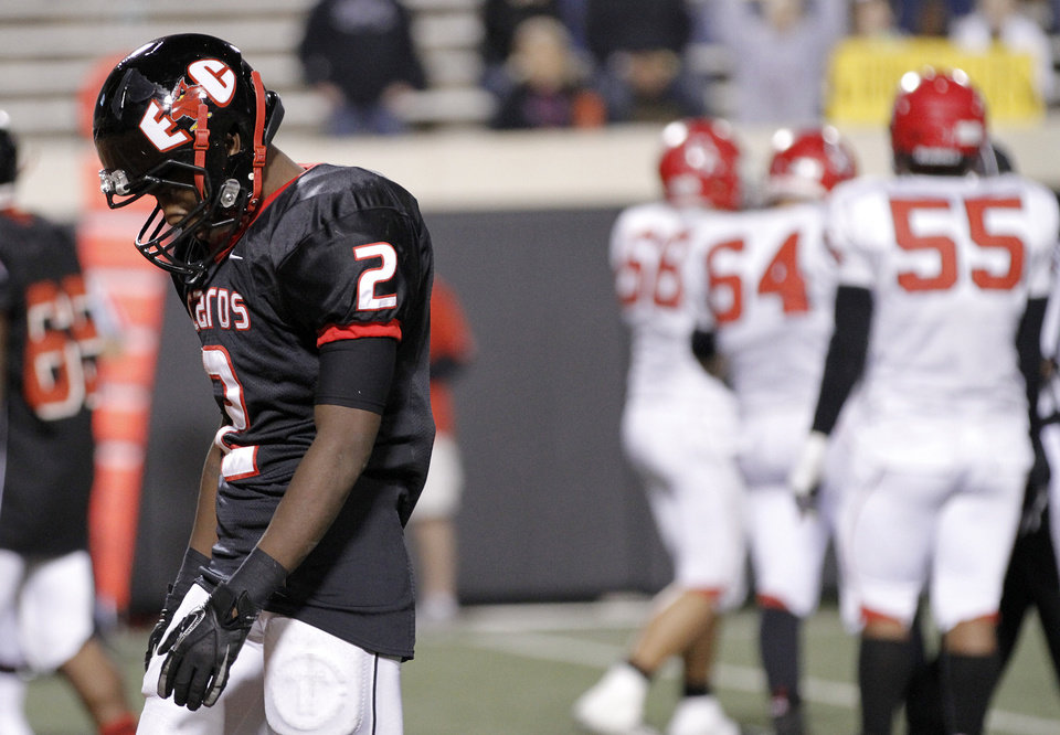 East Central's Stanvon Taylor (2) hangs his head as the Cardinals' get an offensive penalty during the Class 5A Oklahoma state championship football game between Carl Albert High School and Tulsa East Central High School at Boone Pickens Stadium on Saturday, Dec. 1, 2012, in Stillwater, Okla.   Photo by Chris Landsberger, The Oklahoman