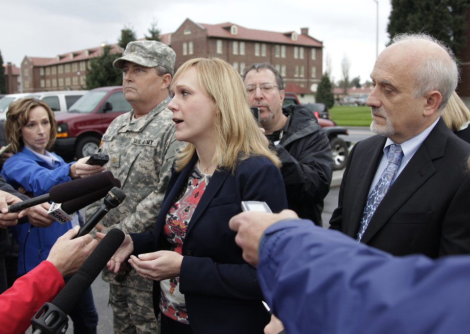 Photo -   Emma Scanlan, center, the civilian defense attorney for U.S. Army Staff Sgt. Robert Bales, talks to reporters, Tuesday Nov. 13, 2012, as she stands with Bales' military defense attorney, Maj. Gregory Malson, second from left, and attorney Lance Rosen, right, on Joint Base Lewis McChord in Washington state, where a preliminary hearing ended Tuesday for Bales, who is accused of 16 counts of premeditated murder and six counts of attempted murder for a pre-dawn attack on two villages in Kandahar Province in Afghanistan last March. (AP Photo/Ted S. Warren)