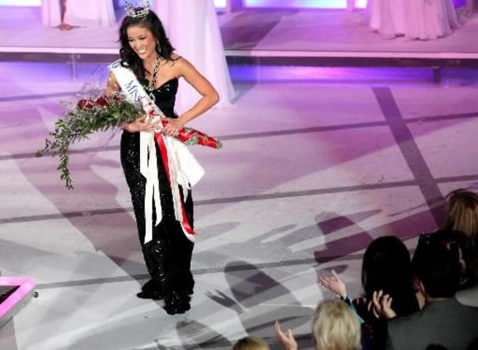 Photo - Alicia Clifton, Miss Edmond LibertyFest, is applauded after being named Miss Oklahoma during the Miss Oklahoma 2012 Pageant at the Mabee Center on the Oral Roberts University campus in Tulsa on Saturday, June 9, 2012. JOHN CLANTON/Tulsa World