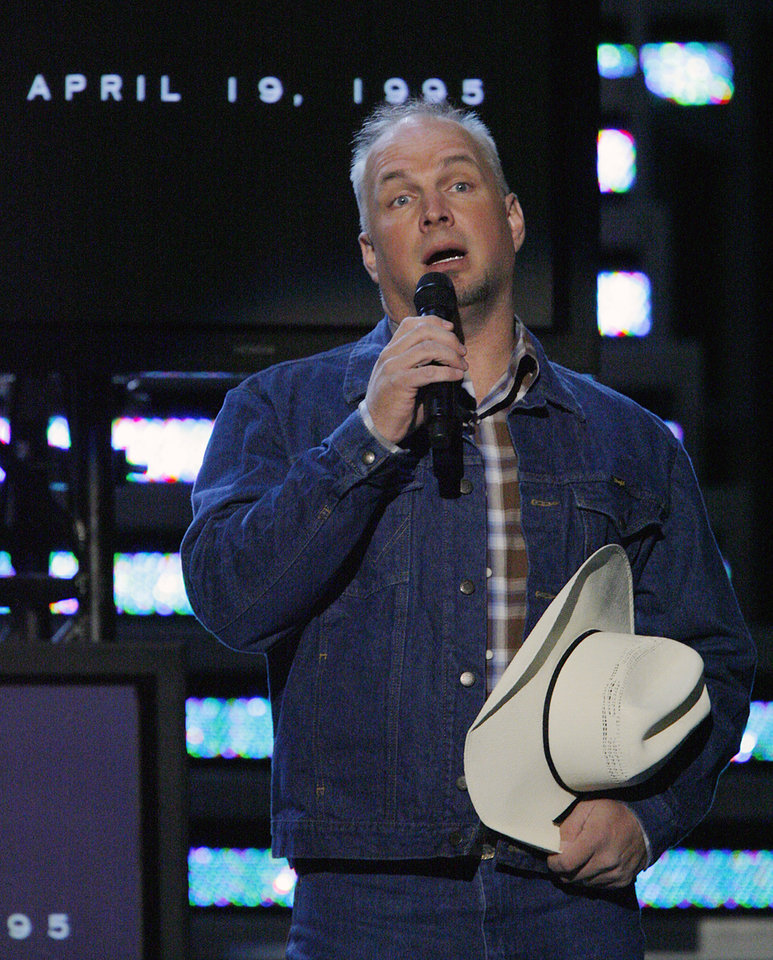 Photo - Garth Brooks pays tribute to the vicitms of the Murrah Federal Building Bombing during the Centennial Spectacular to celebrate the 100th birthday of the State of Oklahoma at the Ford Center on Friday, Nov. 16, 2007, in Oklahoma City, Okla. Photo By CHRIS LANDSBERGER, The Oklahoman