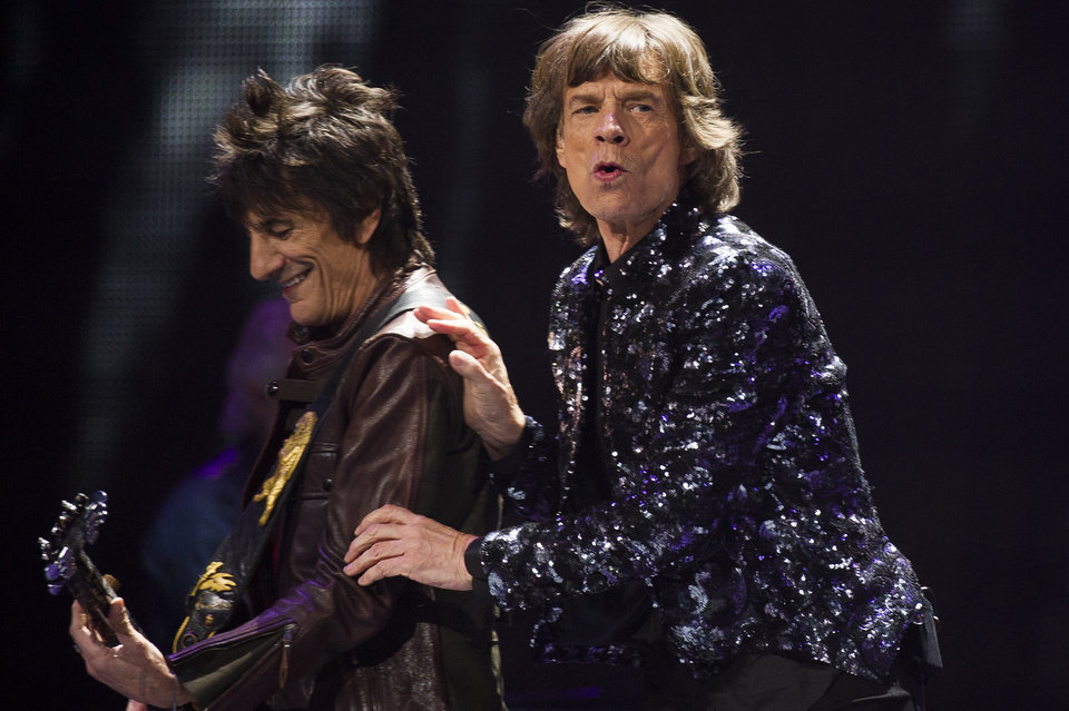 Photo - Ronnie Woods, left, and Mick Jagger of The Rolling Stones perform in concert on Saturday, Dec. 8, 2012 in New York. (Photo by Charles Sykes/Invision/AP)