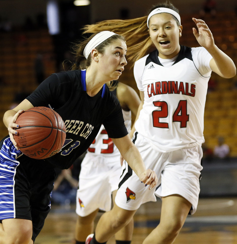 Photo - Deer Creek's Whitney Jones (13) drives the ball against East Central's Kitanna Gritts (24) during the Class 5A girls championship game in the state high school basketball tournament between Deer Creek and Tulsa East Central at the Mabee Center in Tulsa, Okla., Saturday, March 15, 2014. Photo by Nate Billings, The Oklahoman