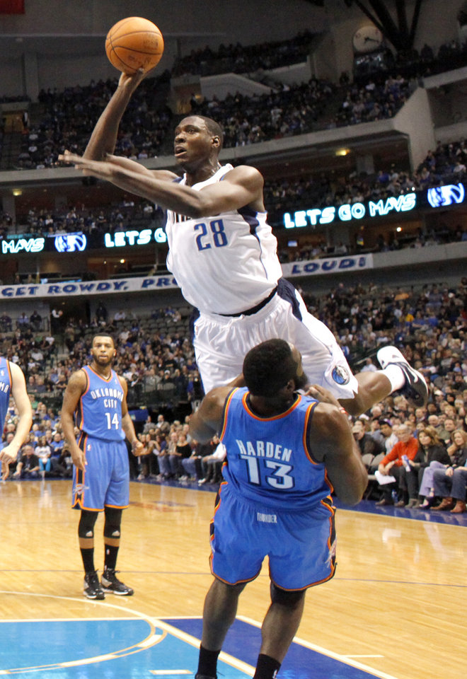 Photo - Dallas' Ian Mahinmi (28) shoots over Oklahoma City's James Harden (13)  during the pre season NBA game between the Dallas Mavericks and the Oklahoma City Thunder at the American Airlines Center in Dallas, Sunday, Dec. 18, 2011. Photo by Sarah Phipps, The Oklahoman
