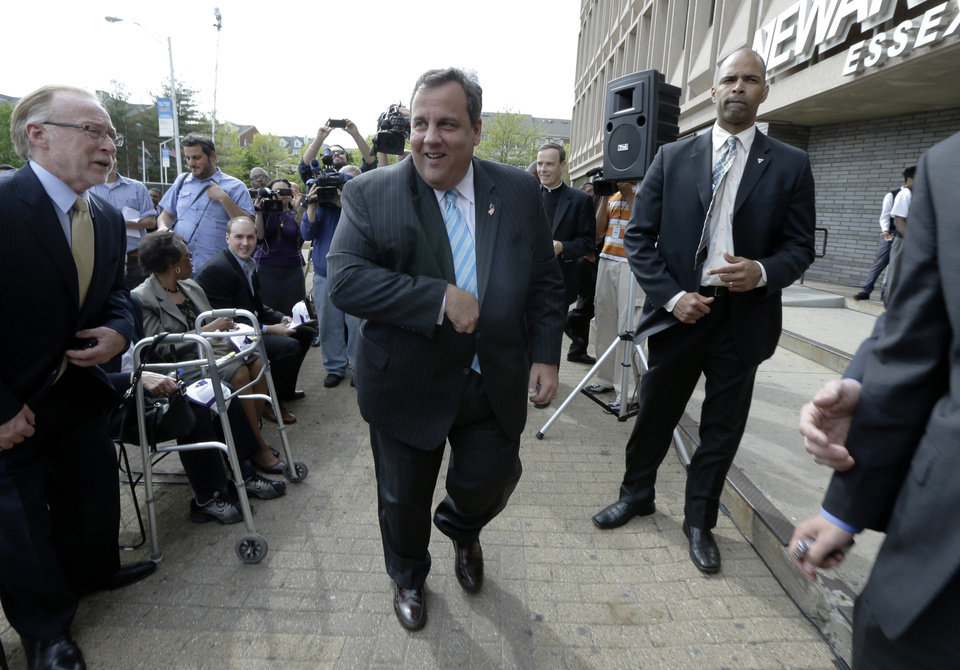 Photo - New Jersey Gov. Chris Christie walks to a podium during the groundbreaking ceremony for the Technology Enhanced Accelerated Learning Center at Essex County Newark Tech, Tuesday, May 7, 2013, in Newark, N.J. Reports say Christie secretly underwent a weight-loss surgery in February, when a band was placed around his stomach to restrict the amount of food he can eat. (AP Photo/Julio Cortez)