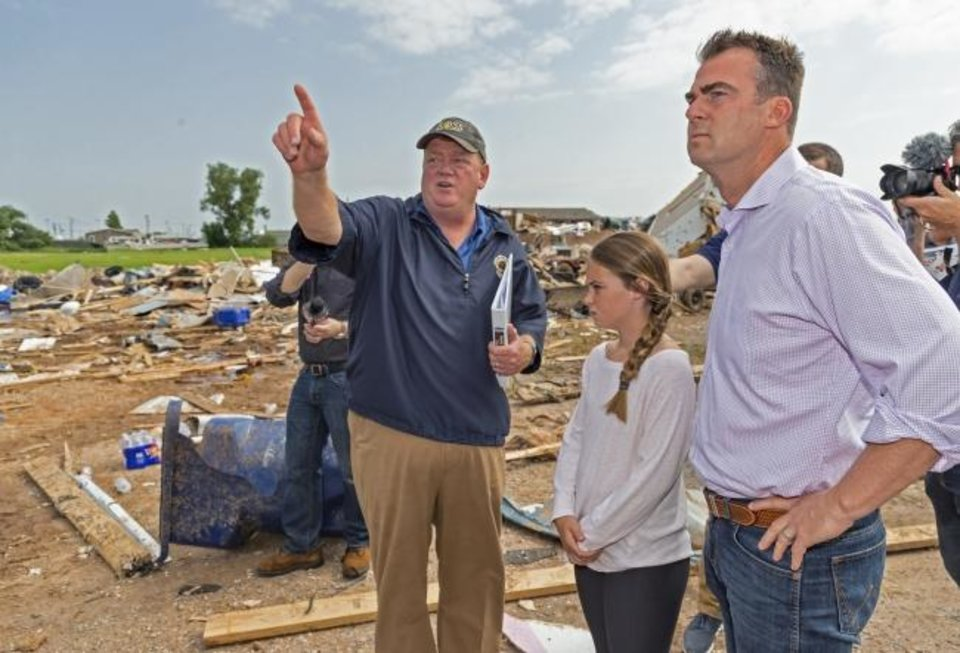 Photo -  El Reno Mayor Matt White, left, shows Gov. Kevin Stitt the aftermath of a tornado in El Reno, Okla. on Monday, May 27, 2019. The EF3 tornado hit the American Budget Value Inn and Skyview Mobile Home Park on Saturday night killing two people and injuring many others. (Chris Landsberger/The Oklahoman,via AP)