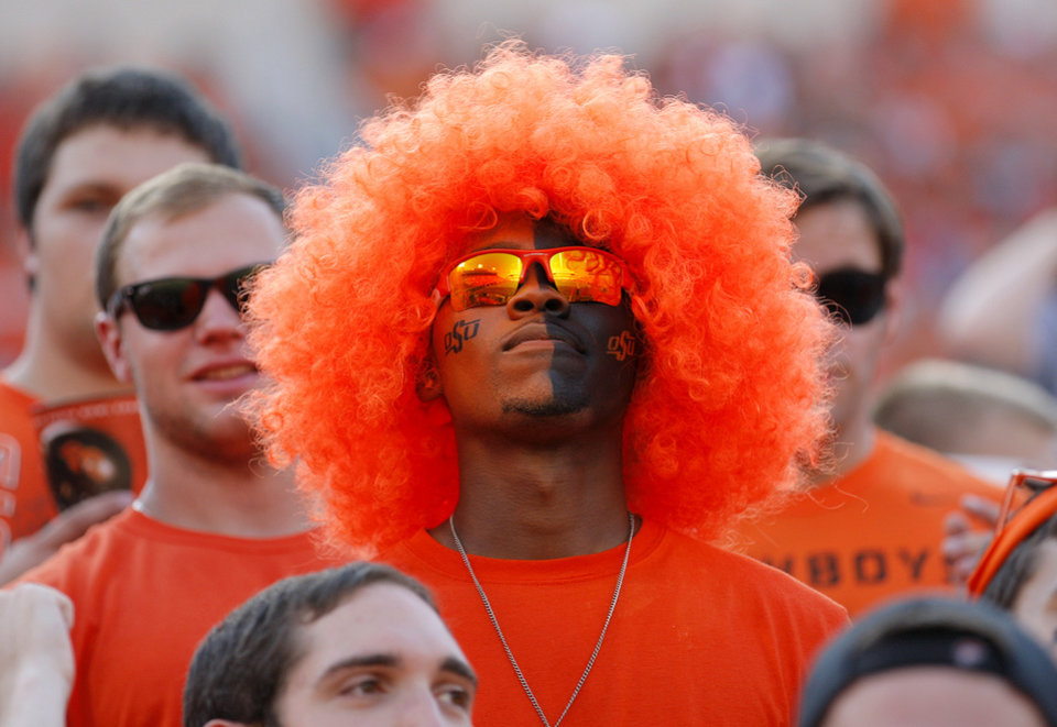 Photo - H'Dari Hayes waits for the start of the college football game between Oklahoma State University (OSU) and Savannah State University at Boone Pickens Stadium in Stillwater, Okla., Saturday, Sept. 1, 2012. Photo by Sarah Phipps, The Oklahoman