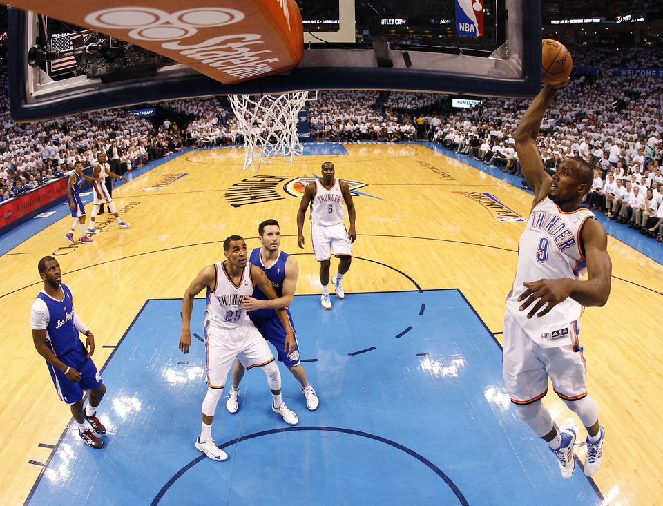 Photo - Oklahoma City's Serge Ibaka (9) goes to the basket during Game 5 of the Western Conference semifinals in the NBA playoffs between the Oklahoma City Thunder and the Los Angeles Clippers at Chesapeake Energy Arena in Oklahoma City, Tuesday, May 13, 2014. Photo by Bryan Terry, The Oklahoman