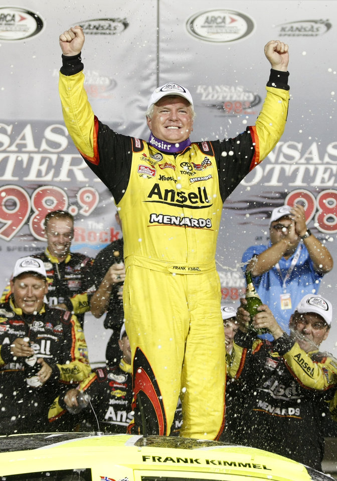 Photo - Frank Kimmel celebrates with his crew after winning an ARCA racing series auto race and the points championship at Kansas Speedway in Kansas City, Kan., Friday, Oct. 4, 2013. (AP Photo/Colin E. Braley)