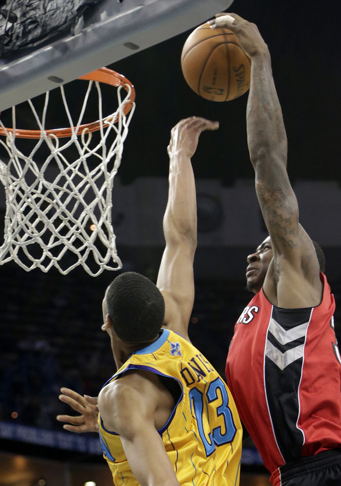 New Orleans power forward Anthony Davis (23) blocks the shot of Toronto power forward Ed Davis (32) during the first quarter of an NBA basketball game at the New Orleans Arena in New Orleans, Friday, Dec. 28, 2012. (AP Photo/Dave Martin)