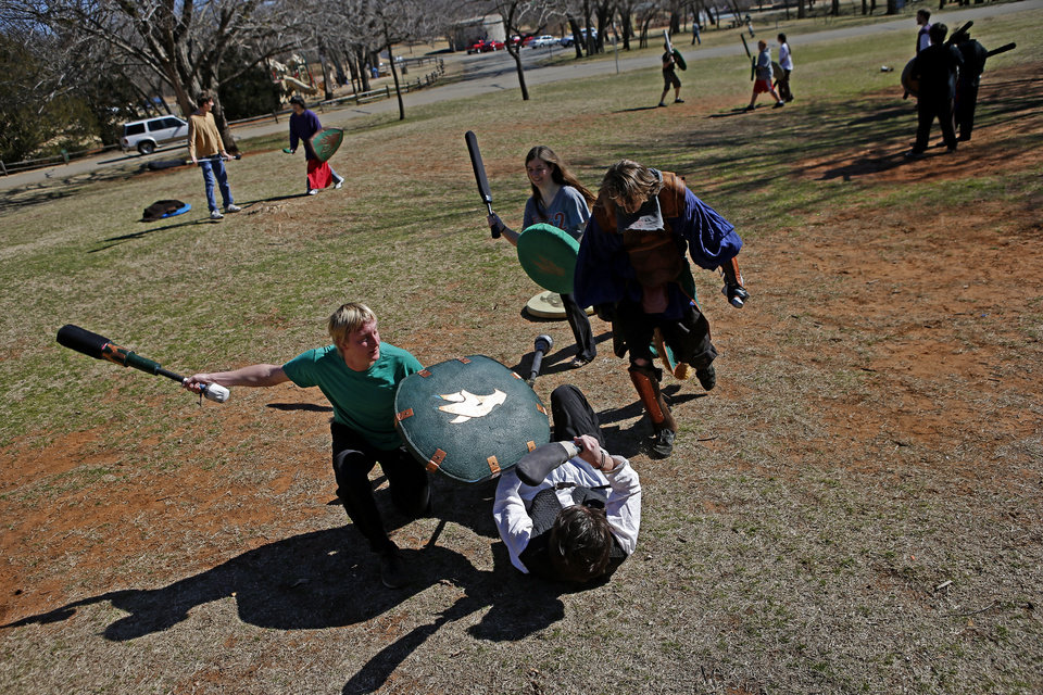 Shaun ANderson, left, fights Mark Jones, on ground, as they practice Dagorhir at Hafer Park in Edmond, Okla., Saturday, Feb. 16, 2013. A group of Dagorhir players meet every Saturday in Hafer park to practice the game that involves battling with foam weapons. Photo by Bryan Terry, The Oklahoman