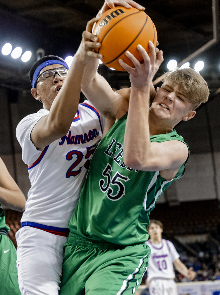 Photo - Leedey's Nathan Hill (55) battles for a rebound with Hammon's Frank Whiteskunk (25) during a Class B boys state tournament semi-final basketball game between Hammon vs Leedey in the Jim Norick Arena at State Fair Park in Oklahoma City, Okla. on Friday, March 6, 2020.  [Chris Landsberger/The Oklahoman]