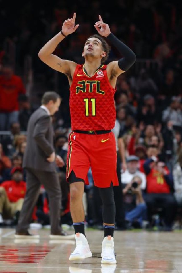 Photo -  Atlanta Hawks guard Trae Young (11) looks to the rafters after making a 3-pointer on Sunday night. Young looked up toward the rafters several times in the game against Washington to honor Kobe Bryant, his mentor and favorite NBA star. [AP Photo/Todd Kirkland]