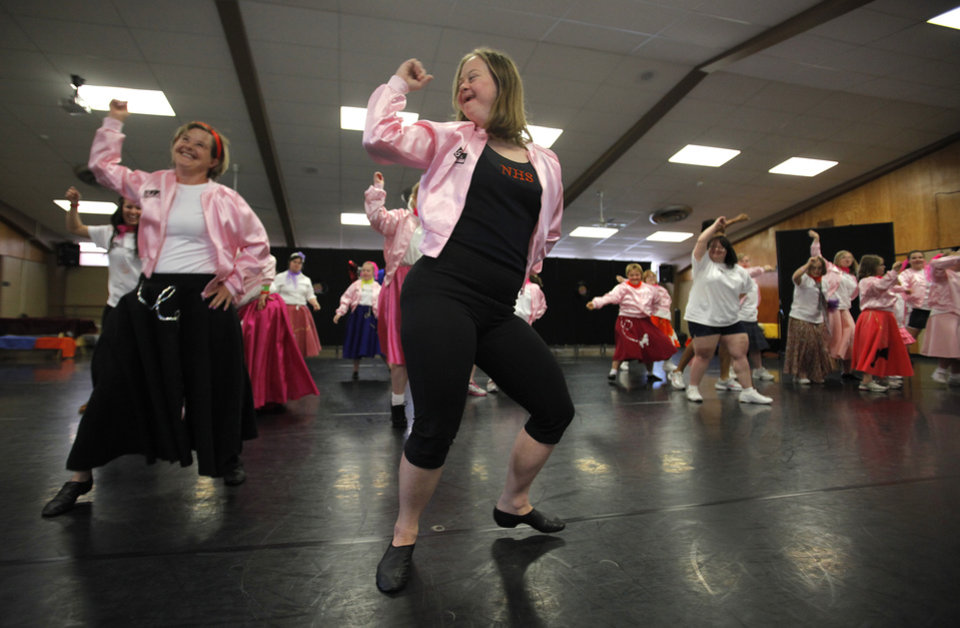 Kathryn Taylor (front) performs during a Dance and Down Syndrome performance of Grease at the University of Central Oklahoma, Friday, June 15, 2012.  Photo by Garett Fisbeck, The Oklahoman