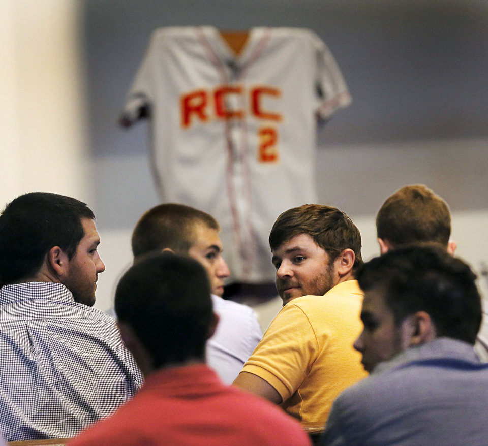 Photo - Baseball players from Redlands Community College in El Reno, Okla., where 22-year-old Australian Christopher Lane used to play, fill the front benches at a memorial service for their former teammate on Saturday, Aug. 24, 2013 in Oklahoma City. Lane was shot in the back and killed last week as he was jogging in an affluent neighborhood in Duncan, in south-central Oklahoma. (AP Photo/The Oklahoman, Jim Beckel) LOCAL STATIONS OUT (KFOR, KOCO, KWTV, KOKH, KAUT OUT); LOCAL WEBSITES OUT; LOCAL PRINT OUT (EDMOND SUN OUT, OKLAHOMA GAZETTE OUT) TABLOIDS OUT ORG XMIT: OKOKL107