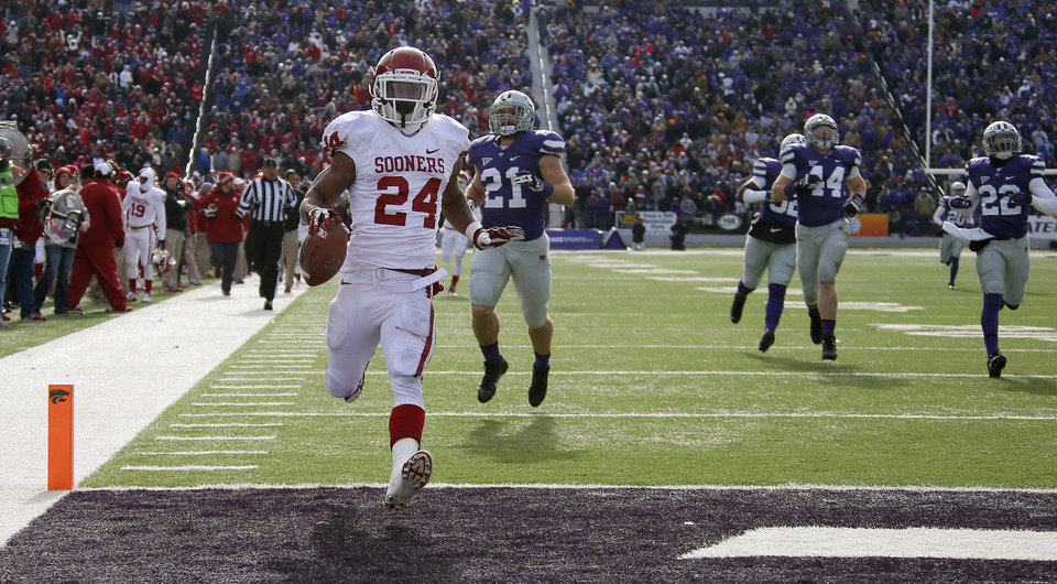 Oklahoma\'s Brennan Clay (24) scores on a 64-yard touchdown run during an NCAA college football game between the Oklahoma Sooners and the Kansas State University Wildcats at Bill Snyder Family Stadium in Manhattan, Kan., Saturday, Nov. 23, 2013. Photo by Bryan Terry, The Oklahoman